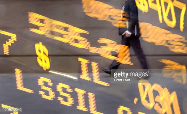 composite image: businessman walking with stock readout board. - digital composite stock pictures, royalty-free photos & images