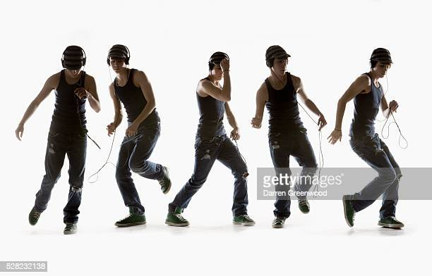 Composite image of a boy dancing with headphones