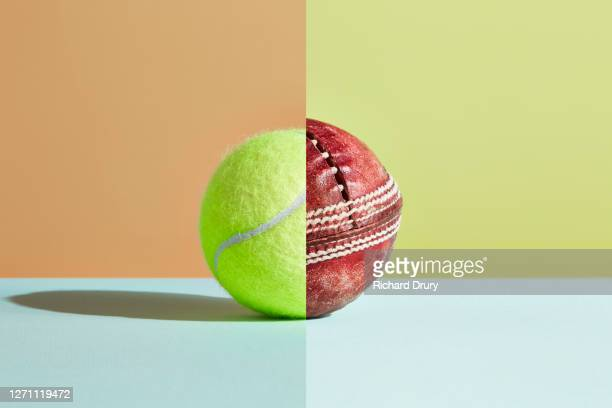 composite image of a new tennis ball and old cricket ball - richard drury stock pictures, royalty-free photos & images