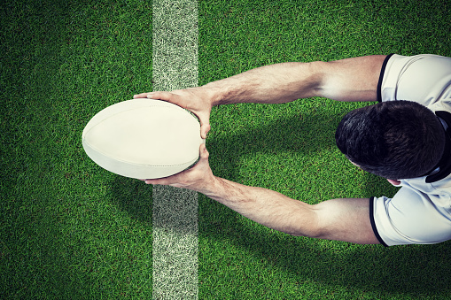 Composite image of a rugby player scoring try 490691398
