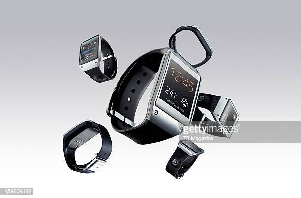 Composite image of a Samsung Galaxy Gear smartwatch photographed on a grey background from different angles created on October 22 2013