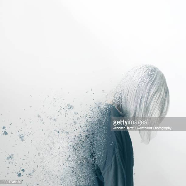 composite image of a woman in profile using dispersion effect - deterioration stock pictures, royalty-free photos & images