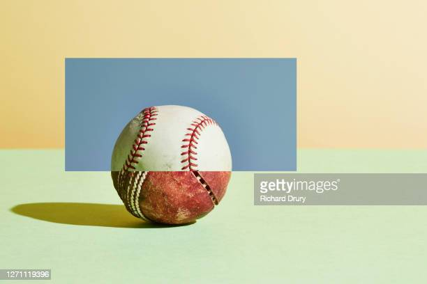 composite image of an old cricket ball and a new baseball ball - single object stock pictures, royalty-free photos & images