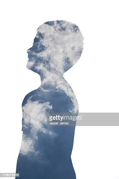 composite image of boy and blue sky and clouds