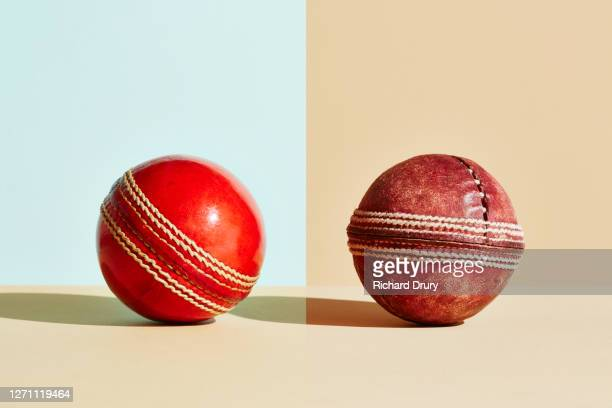 composite image of old and new cricket balls - cricket ball stock pictures, royalty-free photos & images