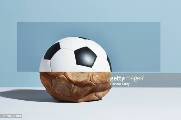 composite image of old and new soccer balls - richard drury stock pictures, royalty-free photos & images