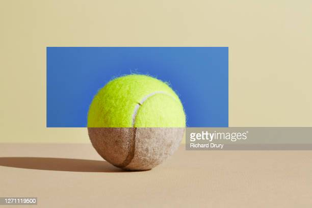 composite image of old and new tennis balls - new stock pictures, royalty-free photos & images