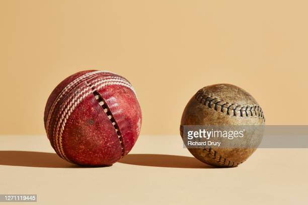composite image of old cricket and baseball balls - cricket ball stock pictures, royalty-free photos & images