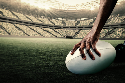 Composite image of rugby player holding ball 490647902