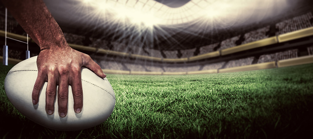 Composite image of rugby player scoring try 490658072