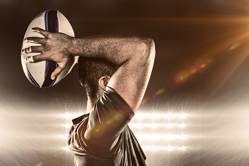 Composite image of rugby player throwing ball 490664806