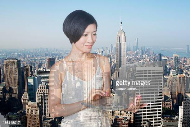 composite image of woman and new york cityscape