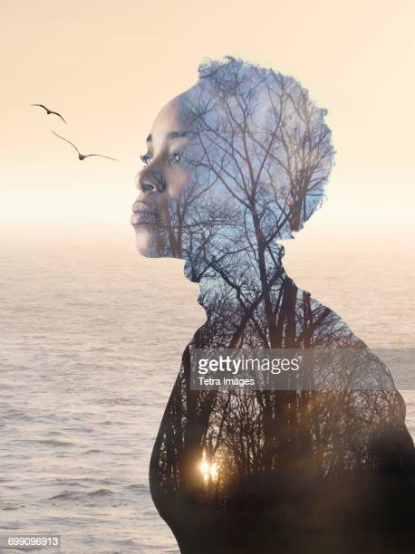 Composite image of woman, forest and seascape