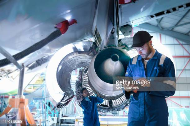 composite image of worker in maintenance factory with digital tablet - air vehicle stock pictures, royalty-free photos & images