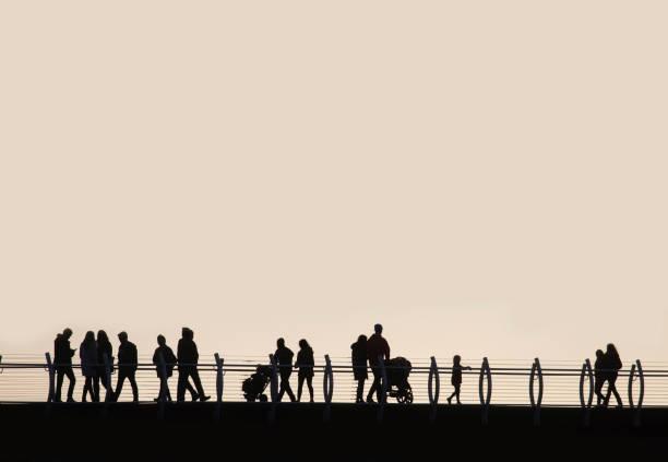 Composite image, pedestrians walking a crosswalk