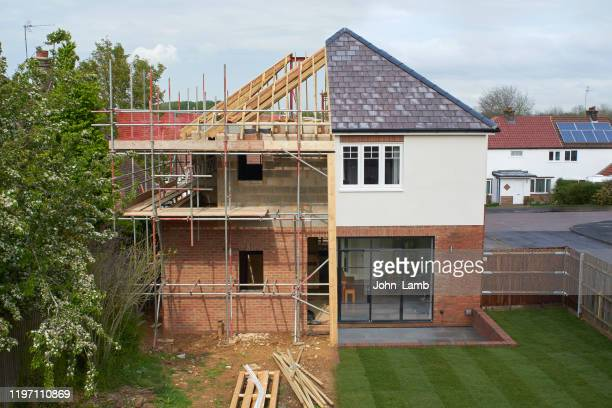 composite of a modern house during and after construction. - brick house stock pictures, royalty-free photos & images