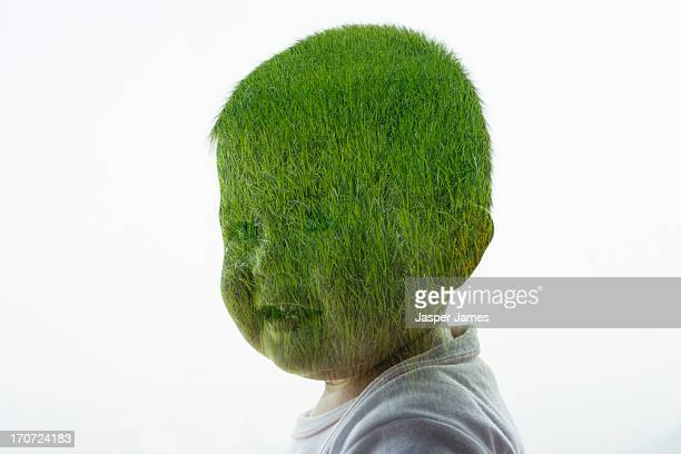 composite of babies head and green grass