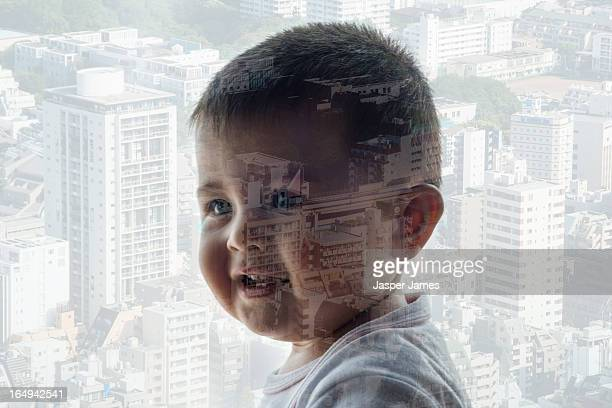 composite of baby and cityscape