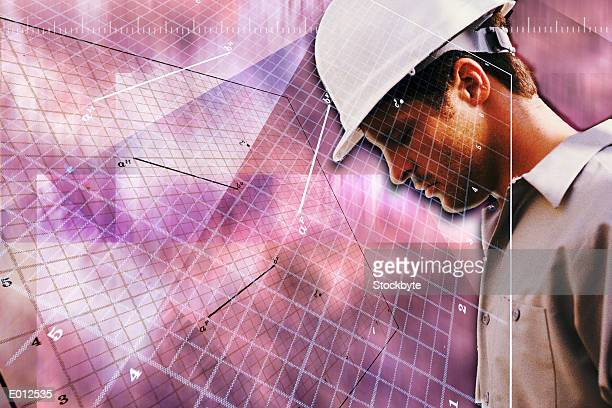 Composite of construction worker in front of grid