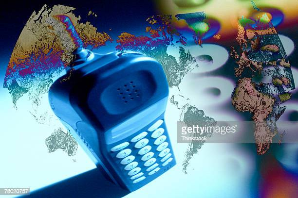composite of cordless phone with globe - thinkstock stock photos and pictures