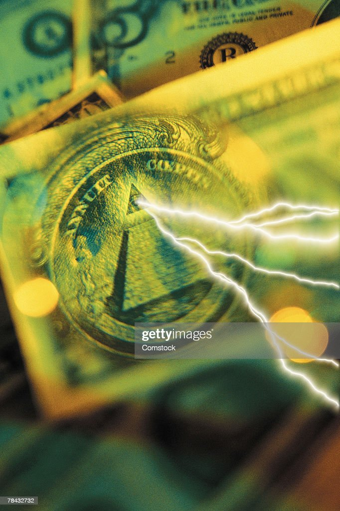 Composite of lightning bolt coming from eye in great seal on dollar bill : Stockfoto