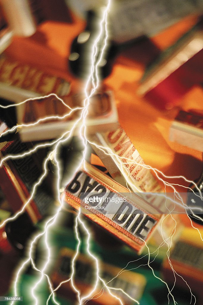 Composite of lightning bolts and assorted rubber stamps : Stockfoto