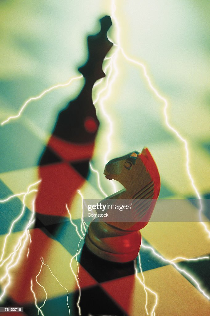 Composite of lightning bolts and chess board with pieces : Stock Photo