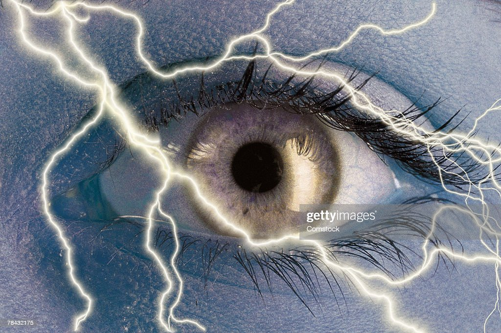 Composite of lightning bolts and human eye : Stock Photo