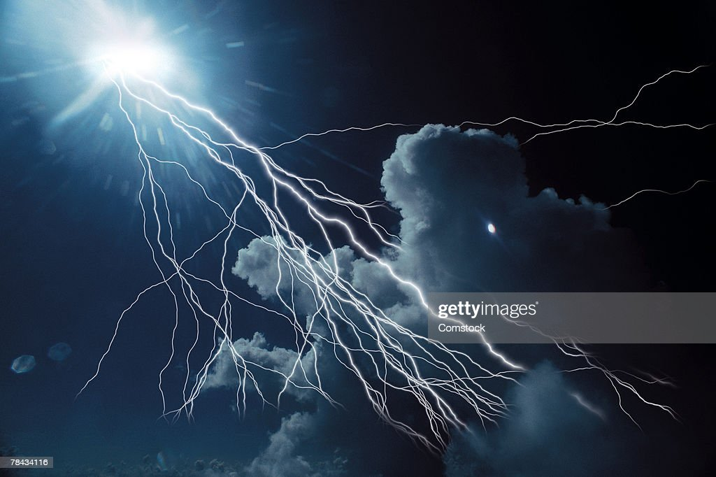 Composite of lightning bolts coming from sun : Stockfoto