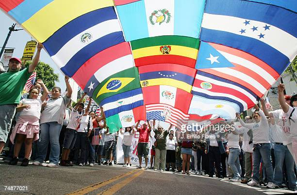 A composite of numerous flags from across the world is held by immigrant reform supporters as they march on Hollywood Boulevard in support of the...