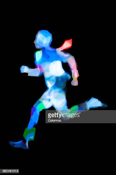 Composite of running business man with light