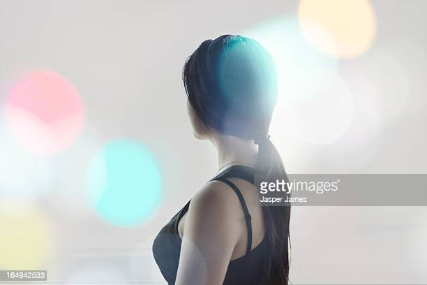composite of woman and blurred lights