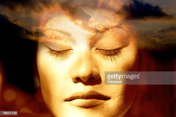 Composite of woman's face and sky