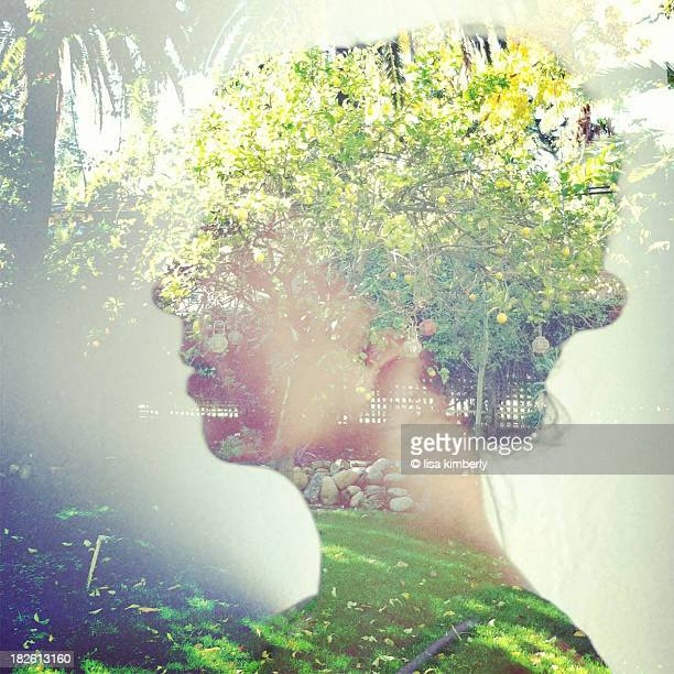 Composite of woman's profile with nature