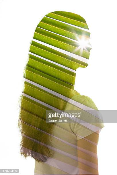 composite of young woman and palm leaf