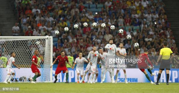 Composite photo shows Cristiano Ronaldo of Portugal scoring a hat trick against Spain from a free kick during the second half of a World Cup group...