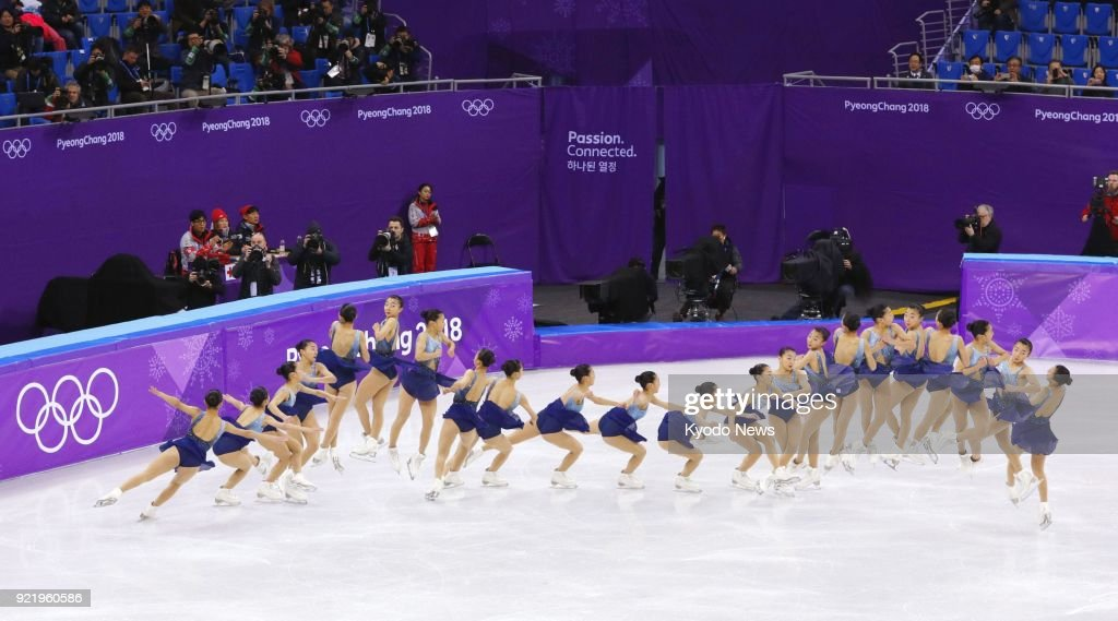 Composite photo shows Kaori Sakamoto of Japan executing a triple flip-triple toeloop combination during the women's figure skating short program at the Pyeongchang Winter Olympics in Gangneung, South Korea, on Feb. 21, 2018. ==Kyodo