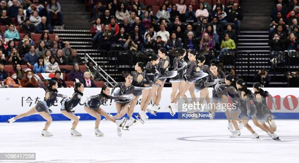 Composite photo shows Rika Kihira of Japan executing a triple axel in the women's free skate at the Four Continents Figure Skating Championships in...