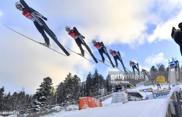 Composite photo shows the first jump of Japan's Sara Takanashi at a women's individual ski jumping World Cup event in Hinterzarten Germany on Dec 17...