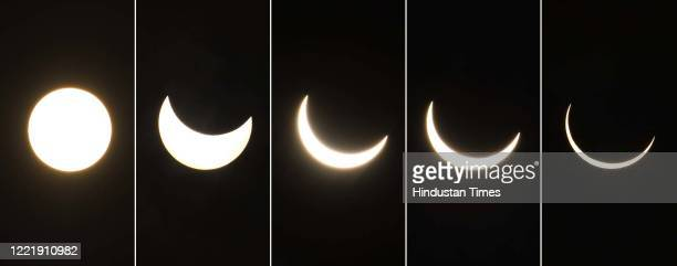 Composite photograph showing stages of the annular solar eclipse at Akshardham, on June 21, 2020 in New Delhi, India.
