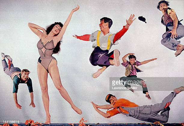 Composite promotional portrait of American actress Julie Newmar, in costume as 'Stupefyin' Jones,' and other various cast members from 'Li'l Abner' ,...