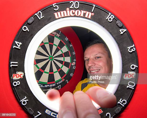 CENTRE SYDNEY NSW AUSTRALIA A composite view of professional darts player Dave Chisnall and the competition dartboard during a press conference ahead...