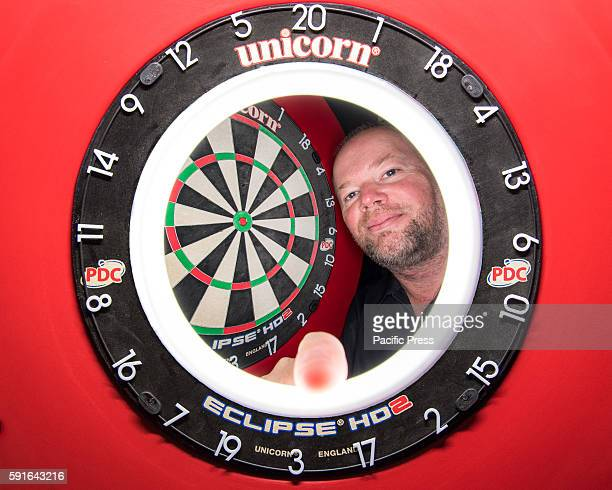 CENTRE SYDNEY NSW AUSTRALIA A composite view of professional darts player Raymond van Barneveld and the competition dartboard during a press...