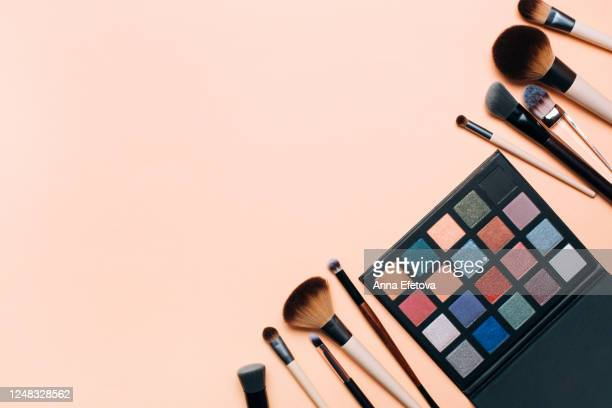 composition of eyeshadows palette and makeup brushes - 舞台化粧 ストックフォトと画像