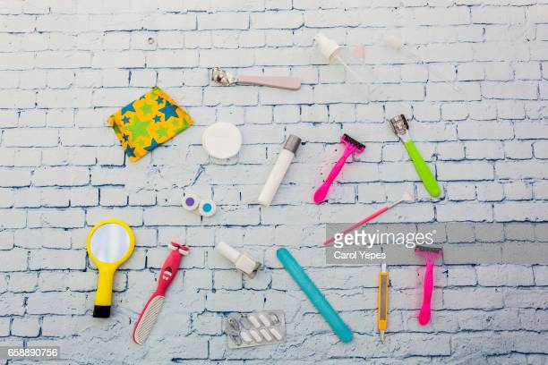 Composition of feminine intimate hygiene set over white background. View from above.