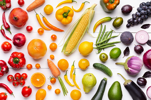 Composition of fruits and vegetables in rainbow colors 1070165924