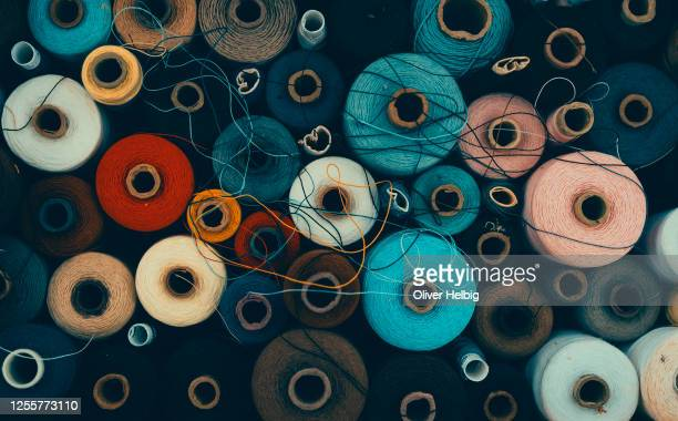 composition of sewing spools with colorful vibrant threads from above - 裁縫道具 ストックフォトと画像