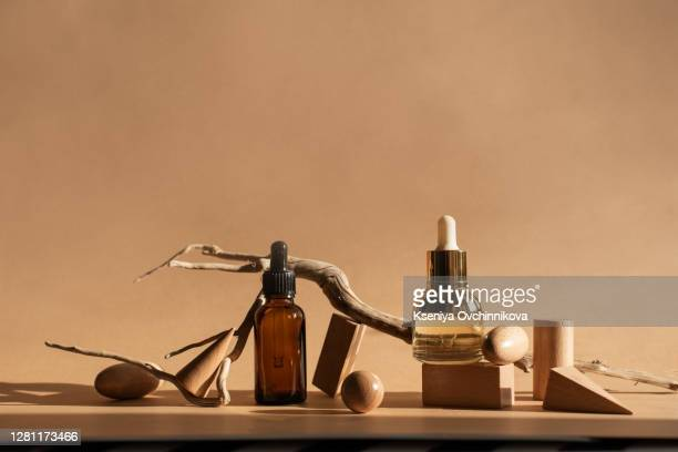 composition with bottles of essential oils on table. natural cosmetics - cosmetics stock pictures, royalty-free photos & images