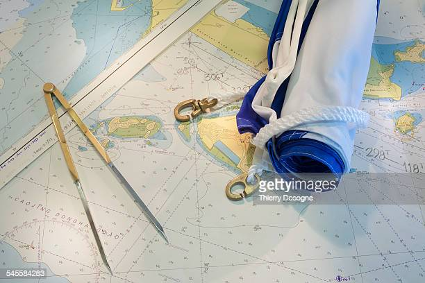 Composition with compass, flag, map