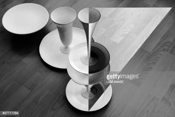 Composition with crockery forming a triangle.